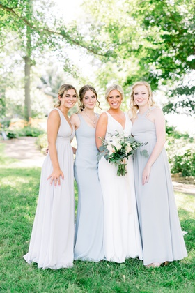 bride in crepe silk sllure gown, bridesmaids in very pale blue dress
