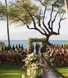 destination wedding in maui, maui wedding overlooking the ocean, wooden aisle