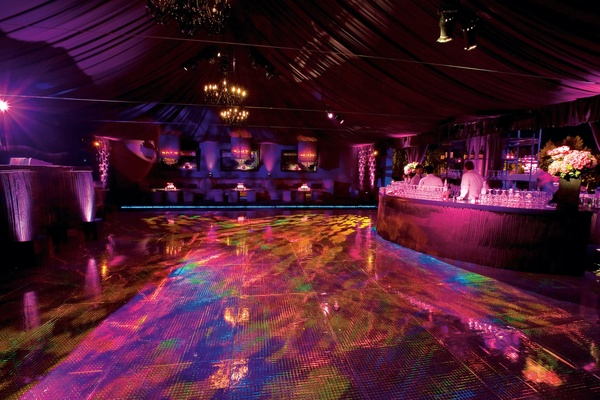 Purple and fuchsia lighting on bar and tent