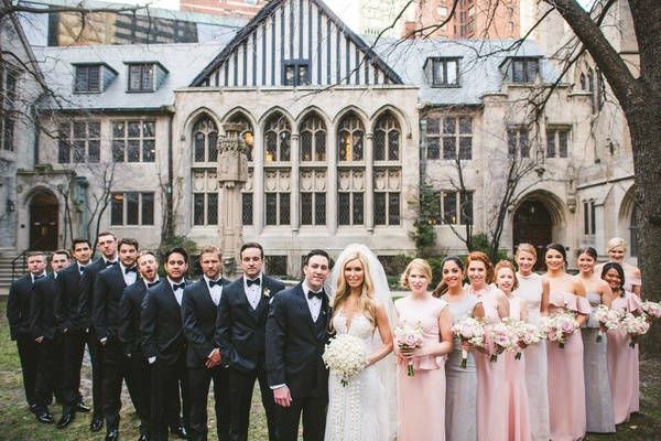bride in pretty wedding dress veil blonde hair pink silver bridesmaid dresses groomsmen in suits