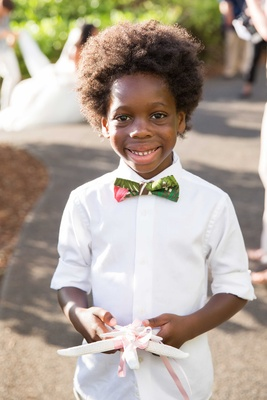 Diana Ross grandson ring bearer with white rolled up shirt sleeves tropical print bow tie star fish