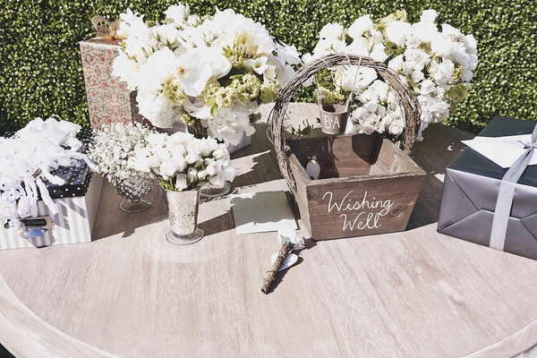 Wishing Well guest book and small floral arrangements