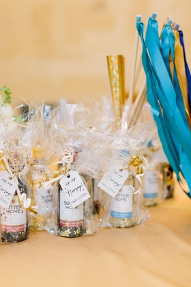 "mini wine bottles as wedding favors with confetti ""sip sip hooray!"""