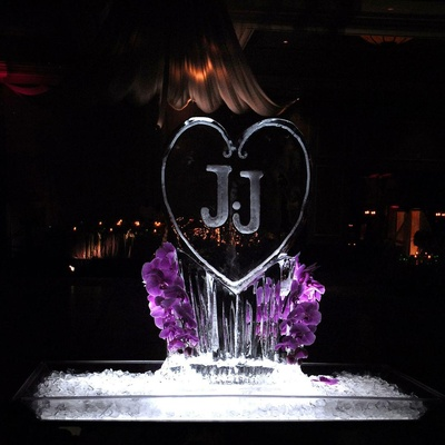 Purple orchids decorating monogrammed ice