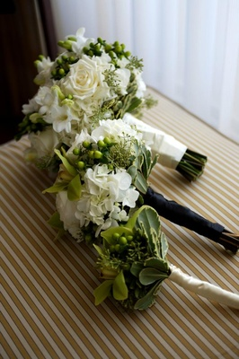 Cream nosegays and bouquet tied with ribbon
