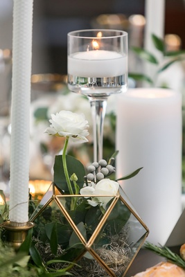 brunia berries, white flowers, greenery in gold edge geometric terrarium, various candles