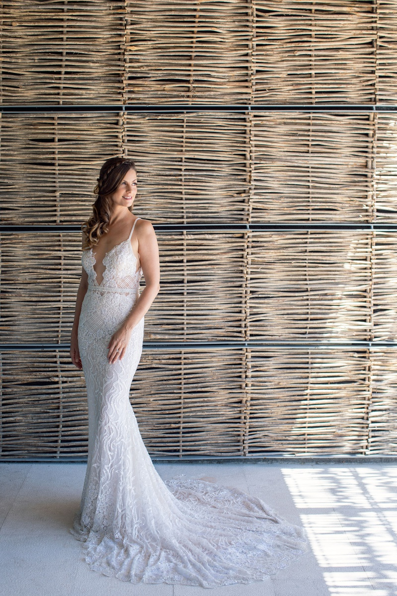 wedding portrait of bride in berta wedding dress long hair pulled to side plunging neckline form fit