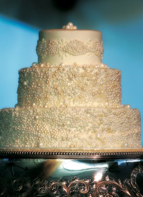 Three layer cake with ivory pearls