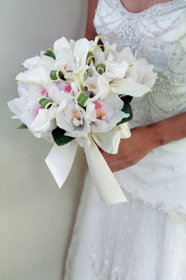 bridal bouquet of lilies, orchids and palm fronds
