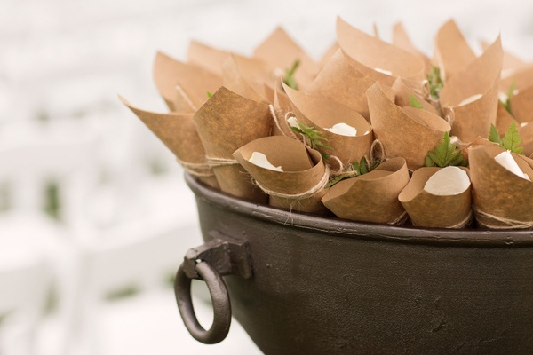 Wedding ceremony outdoor vineyard kraft paper cone filled with white rose petals