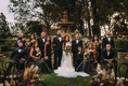 Bride and groom with bridesmaids in black dresses and groomsmen ring bearer Stephanie Perez