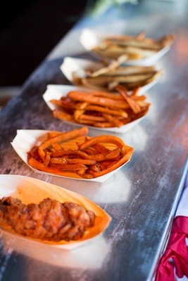 Paper bowls of sweet potato and regular french fries