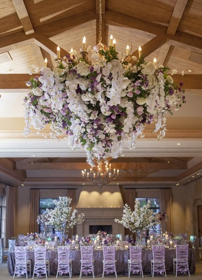Indoor reception space with wood beams and flowers