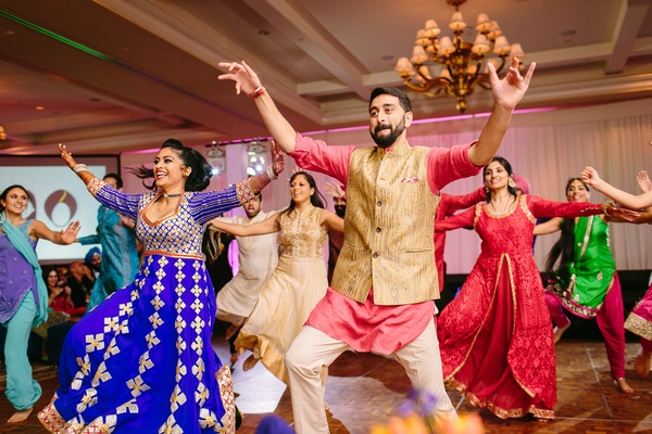sangeet reception party, south asian couple joining the dance performers