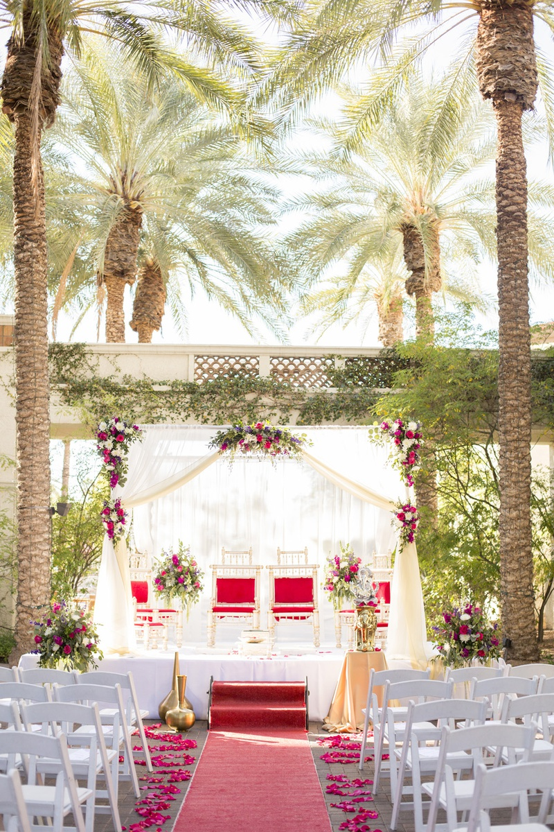 south asian wedding inspiration, palm trees, red carpet aisle runner, mandap