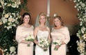 Bride with bridesmaids in long sleeve bridesmaid dresses