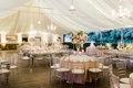 calamigos ranch tented wedding reception, draped fabric with twinkle lights