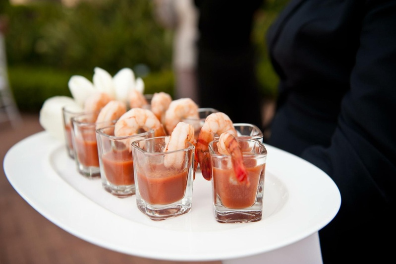 Shot glasses filled with shellfish and cocktail sauce
