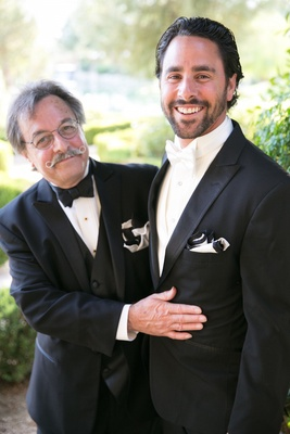 Men in tuxedos and bow ties with unique moustache