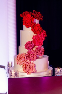 An ombr inspired chicago wedding in the round inside weddings white cake with sugar flowers cascading down side in shades of pink mightylinksfo