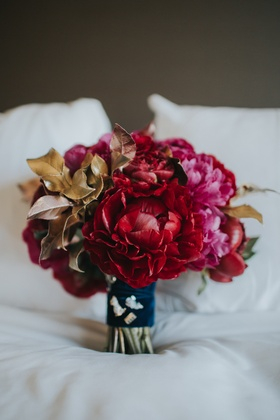 moody fall bridla bouquet with red and magenta peonies, magnolia leaves