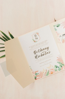 wedding invitation pink green peach flower tropical foliage watercolor monogram crest calligraphy
