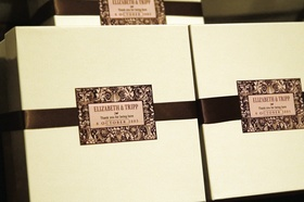 Wedding favor boxes with brown ribbon and name card