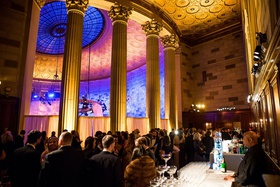 wedding reception cocktail hour gotham hall large columns high ceiling dome gold ceiling