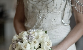 Bride's bouquet of white roses and rhinestone broaches