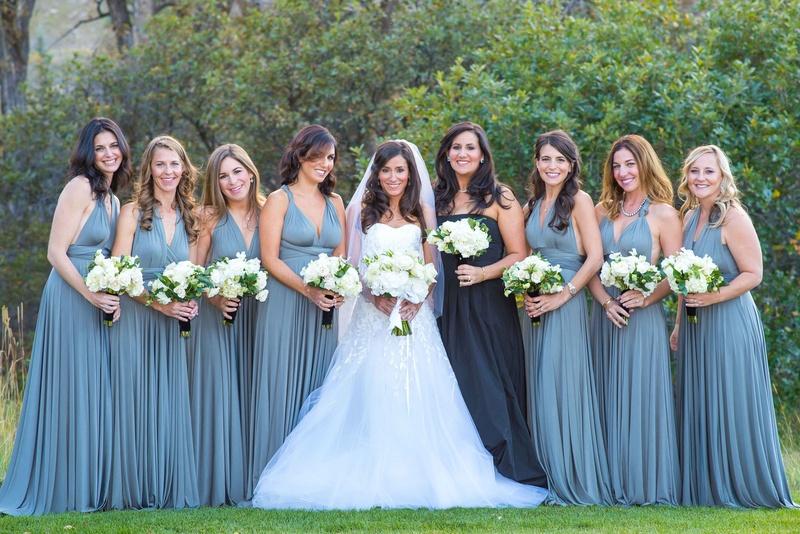 Bride in Carolina Herrera wedding dress with bridesmaids in long blue BHLDN bridesmaid dresses