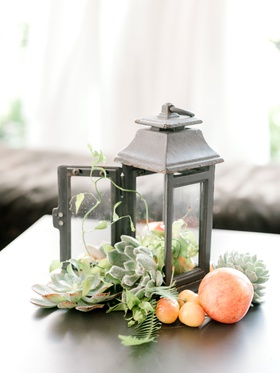 summer bridal shower decor idea rustic lantern filled with succulent fresh cherry plum fruits greens