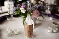 Lyndsy Fonseca wedding with diy glass bottle kraft paper table number sticker