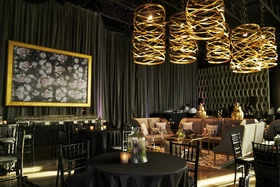 black and gold lounge area for wedding cocktail hour, dark and moody setting