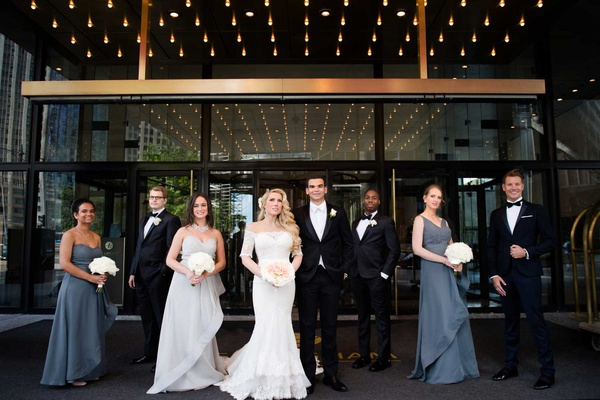 bridesmaids in mismatched dresses and groomsmen in tuxedos black bow ties groom white tie