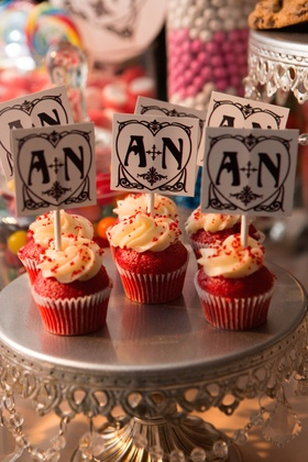 A + N wedding monogram tags on top of red cupcakes