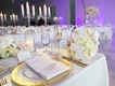 hammered charger with gold trim, sweetheart table with orchids