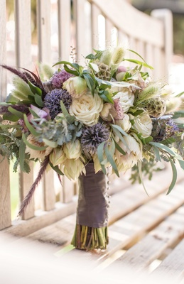 neutral tones rustic bouquet blue purple white green different kinds of flowers