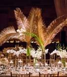 wedding reception centerpiece white flowers gold sago palm leaves greenery long rectangular table