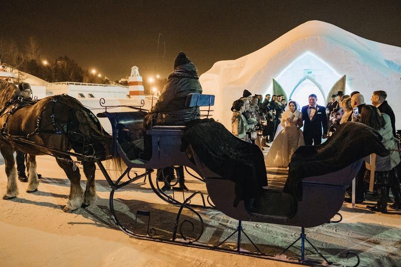 ice castle wedding ceremony unique venue horse drawn carriage winter wedding ideas