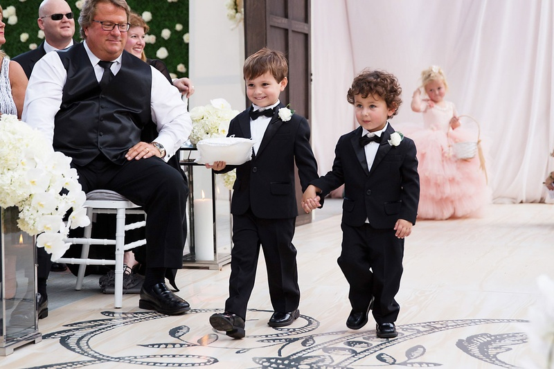 Wedding ceremony wood aisle runner monogram two ring bearers tuxedos bow ties boutonnieres
