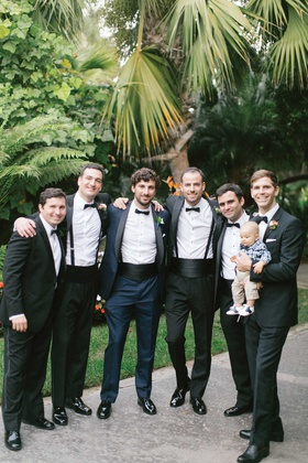 wedding portrait groomsmen tuxedos and baby in plaid shirt bow tie groom in navy tuxedo black lapel