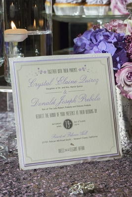 White wood invite border and purple lettering
