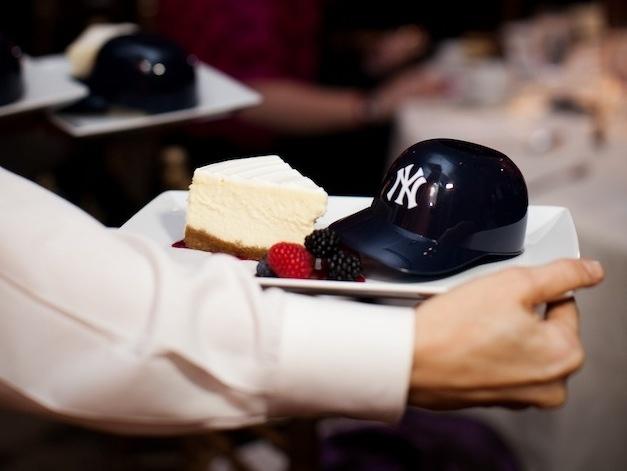 Cheesecake with mini baseball helmet