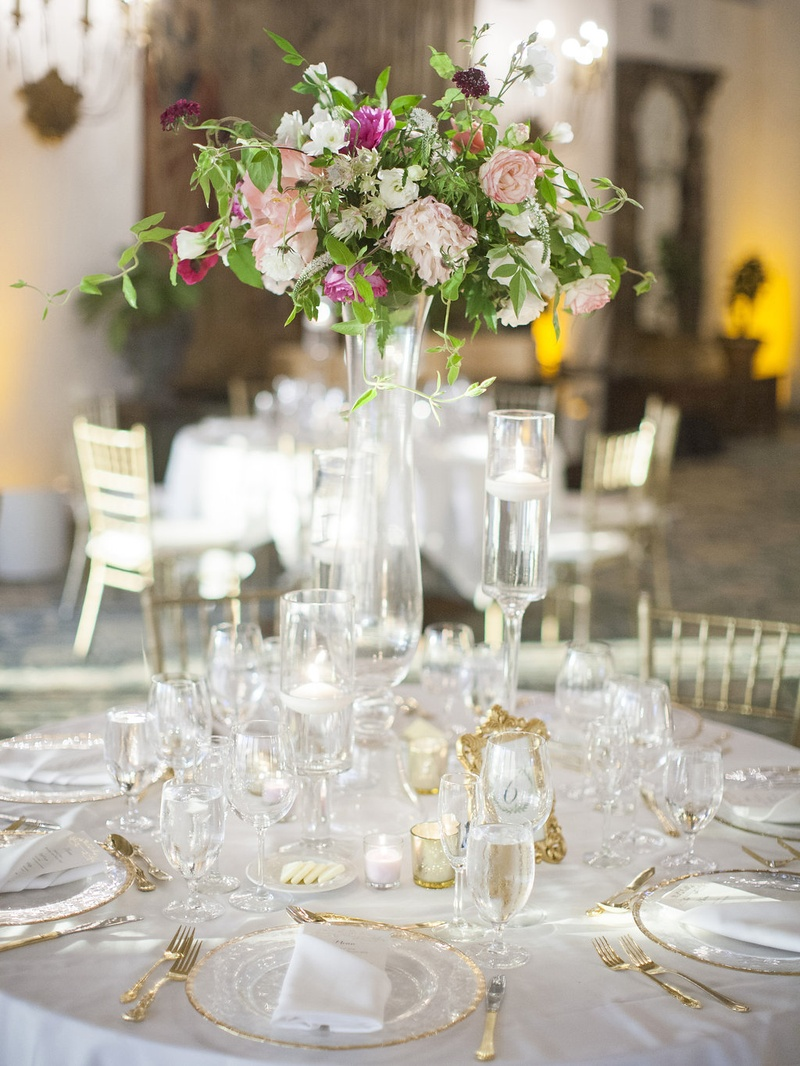 Reception décor photos tall floral centerpiece on round