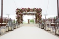 Chuppah with pink flowers branches greenery, Lanterns, tented venue, Jewish ceremony