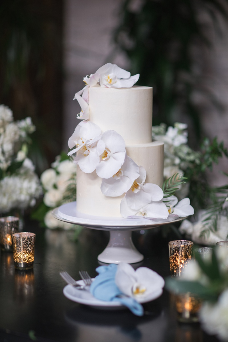small two-tier cake with cascading orchids down the side