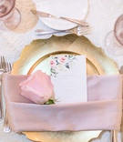 wedding reception place setting gold charger plate pink napkin blush rose and flower print menu