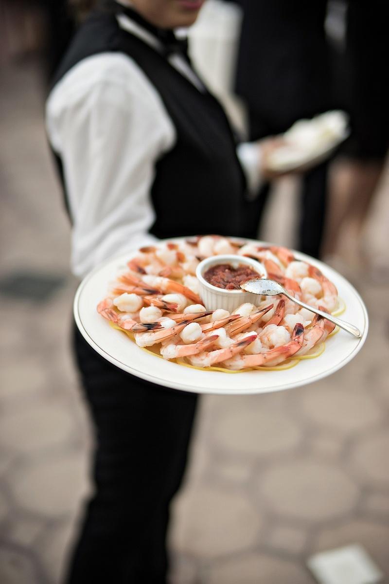 server with platter of shrimp at wedding cocktail hour