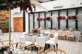 edgy bridal shower at restaurant patio with dark and moody color scheme
