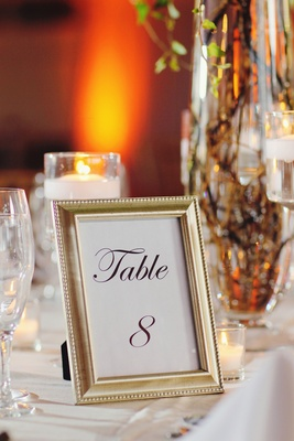 Antique-style gilt frame with table number on guest table